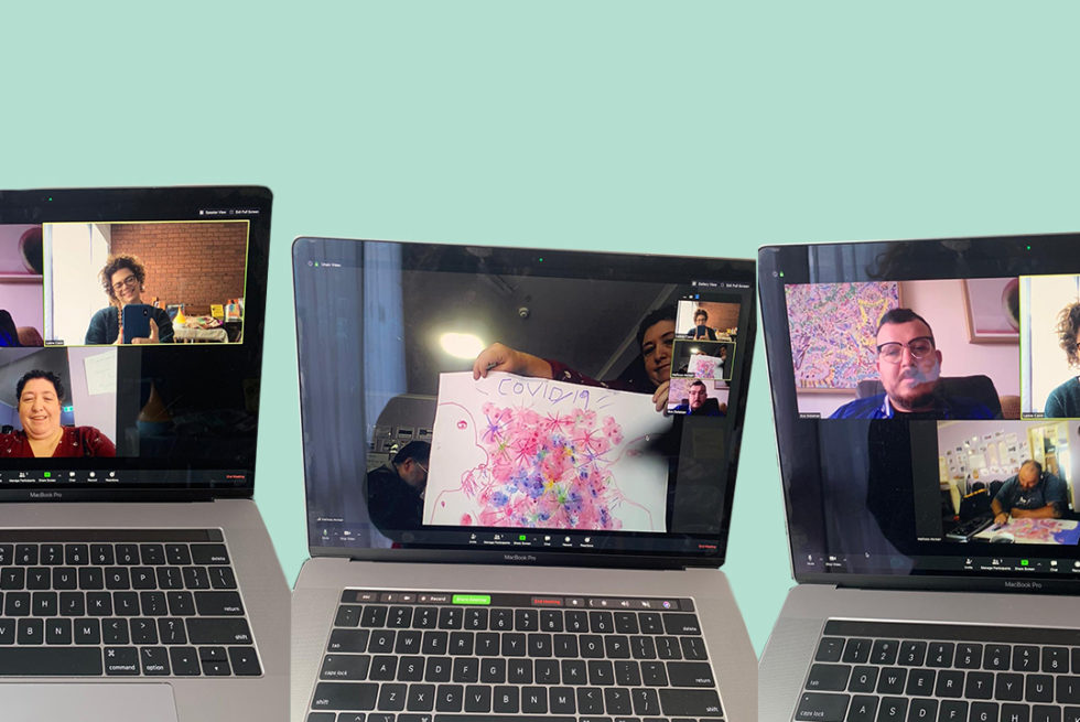 Three laptops with a Zoom call on the screens.