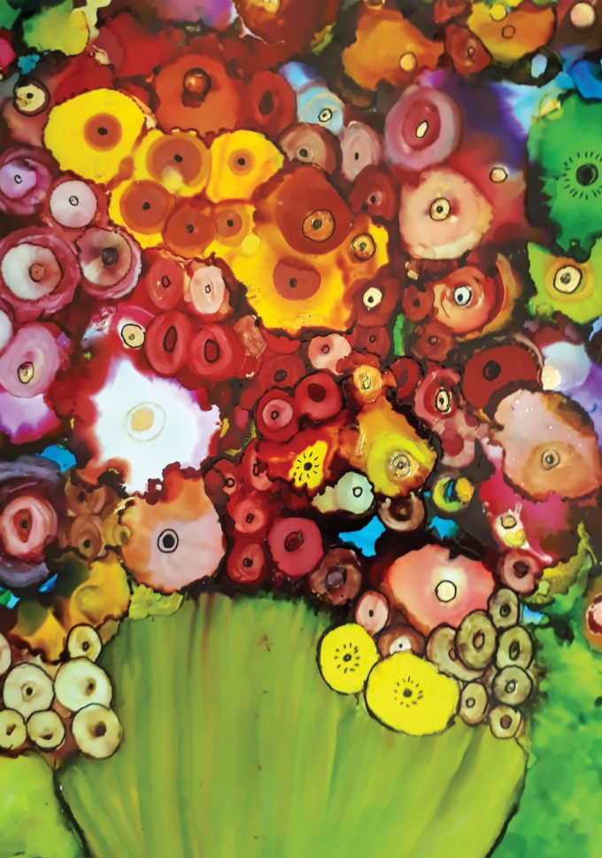 An abstract oil inks painting of flowers, filled with many colours.