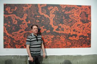 Jonathon Goodfellow standing in front of is artwork