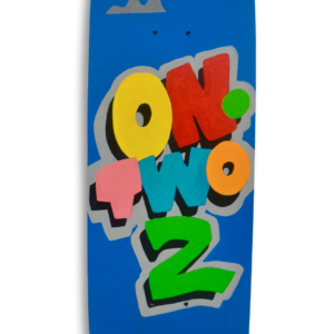 "A skateboard with a blue sky background and the text in colourful letters ""On Two 2"" and the logo ""Dismay"" resembling the Disney logo."