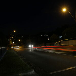 A photograph of a road taken at night time.