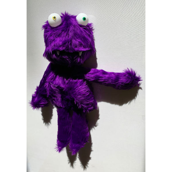 a furry purple monster with yellow and green eyes.